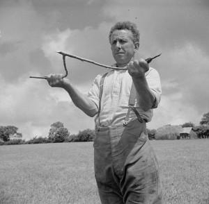 Farmer with dowsing rod
